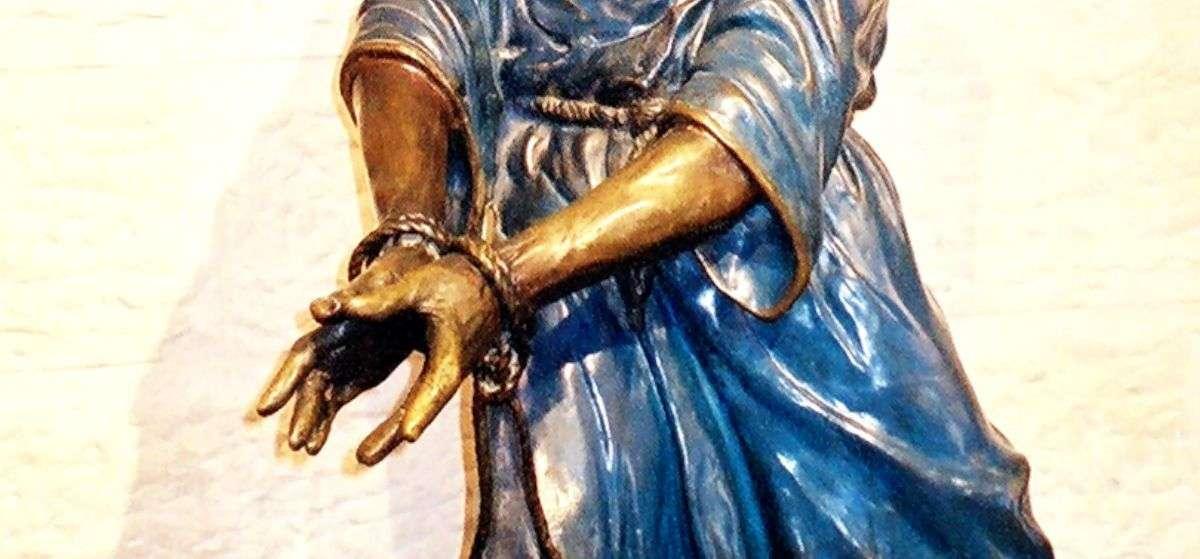 the hands of Jesus tied